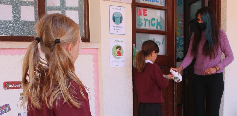 Junior School – Grade 3: Practicing safety measures before entering the classroom.
